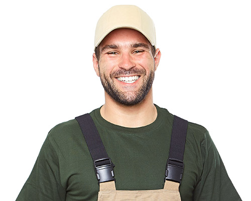 Portrait of smiling worker in brown uniform with tools isolated on white background